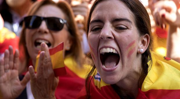 Protesters in Barcelona show their opposition to secession (AP)