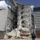 A police officer stands guard at an apartment building that was partially destroyed during the 7.1-magnitude earthquake, on Emiliano Zapata Avenue in Mexico City. (AP Photo/Miguel Tovar)