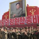 Soldiers applaud during an event marking the 20th anniversary of the election of former North Korean leader Kim Jong Il in Pyongyang. (AP Photo/Jon Chol Jin)