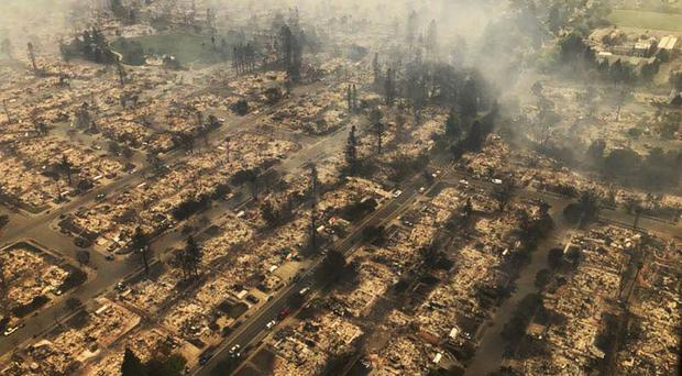 Aerial photo showing some of hundreds of homes destroyed in a wind-driven wildfire that swept through Santa Rosa, California, early on Monday (California Highway Patrol via AP)