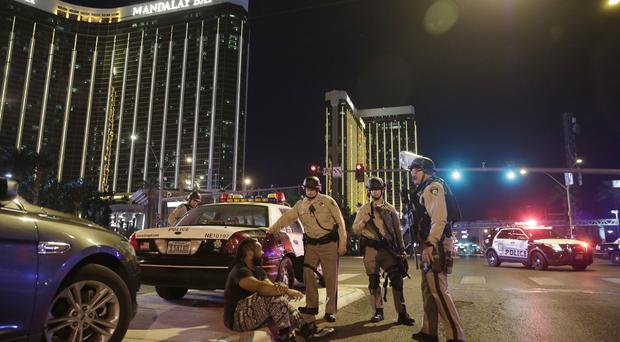 Police at the scene of the mass shooting outside the Mandalay Bay hotel on the Las Vegas Strip (AP Photo/John Locher, File)