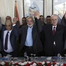 Hamas and Palestinian leaders celebrate reaching an agreement on control of the Gaza Strip after Egyptian-brokered talks (AP Photo/Prime Minister Office, File)