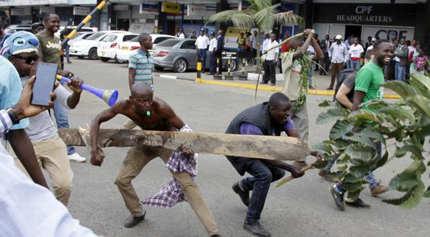 Opposition supporters demonstrate against electoral authorities in Kenya (AP)