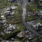 Destroyed communities are seen in the aftermath of Hurricane Maria in Toa Alta, Puerto Rico (AP)