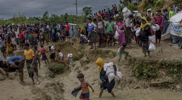 Rohingya refugees leave the Balukhali refugee camp after the elephant attack