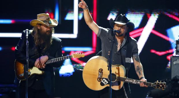 Chris Stapelton and Jason Aldean perform at CMT Artist of the Year Awards in honour of the Las Vegas shooting victims (Wade Payne/Invision/AP)