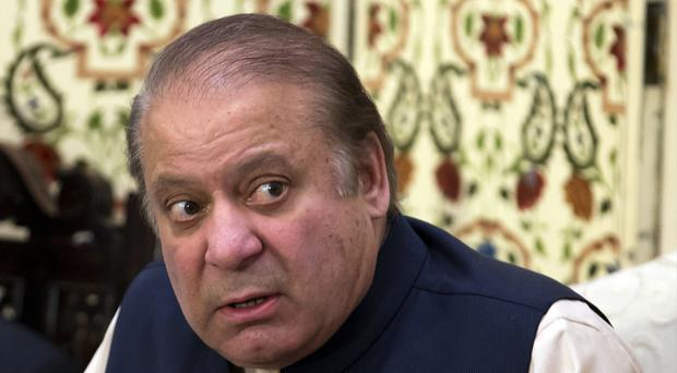 Pakistan's former prime minister Nawaz Sharif faces charges in three corruption cases (AP Photo/B.K. Bangash, File)