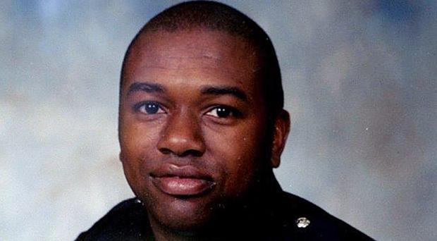 Police officer Anderson Gordon was killed in 1997 (Montgomery Police/AP)