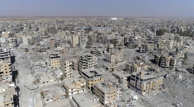 Damaged buildings in Raqqa after Syrian Democratic Forces said operations to oust IS have ended and they have taken full control of the city (AP Photo/ Gabriel Chaim)