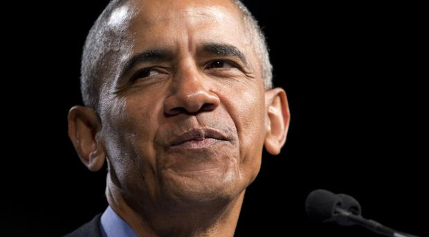 Former president Barack Obama listens to the crowd during a rally with Virginia's Democratic gubernatorial candidate (AP)