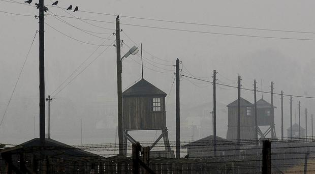 Watchtowers and barbed wire fencing surround the former Nazi death camp Majdanek, photographed outside the city of Lublin in eastern Poland in 2005 (AP)