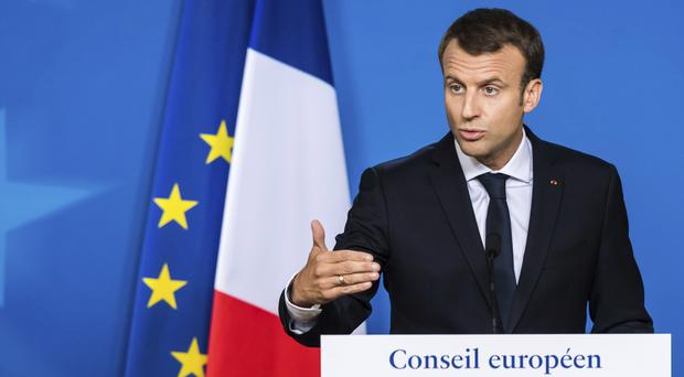 Mr Macron speaks during a media conference at the conclusion of an EU summit in Brussels (AP)