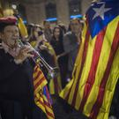 People gather outside the Palau Generalitat in Barcelona, Spain, awaiting for Catalan President Carles Puigdemont's speech on Saturday (AP Photo/Santi Palacios)