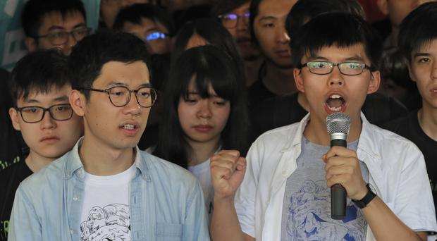 Hong Kong activist Joshua Wong, right, and Nathan Law, left (AP)