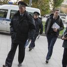 Police officers arrive at the Ekho Moskvy radio station office in Moscow after its deputy editor-in-chief was stabbed (AP Photo/Alexander Zemlianichenko)