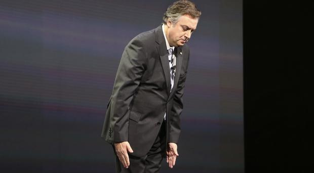 Nissan executive vice president Daniele Schillaci bows at the Tokyo Motor Show as he expresses remorse for widespread illegal inspections at the carmaker (AP Photo/Koji Sasahara)