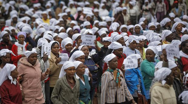 Kenyan women gather outside the Supreme Court in Nairobi for a multi-faith demonstration calling for peace (AP)
