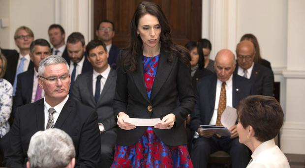 Jacinda Ardern reads the oath as she is sworn in as New Zealand prime minister (Mark Mitchell/New Zealand Herald via AP)