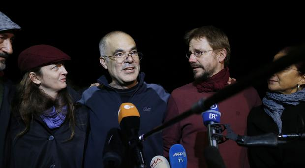 Ali Gharavi and Peter Steudtner after their release from Silivri prison outside Istanbul (AP)