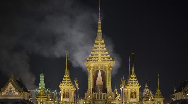 Smoke rises from the royal crematorium of Thailand's late King Bhumibol Adulyadej in Bangkok (AP Photo/Wason Wanichakorn)