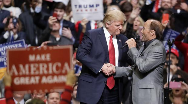 Donald Trump with the right Lee Greenwood at a rally in Nashville (AP)