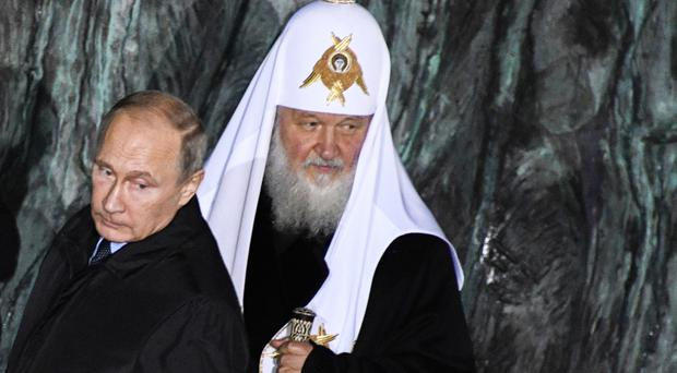 Vladimir Putin and Orthodox Patriarch Kirill attend a ceremony in Moscow (AP)