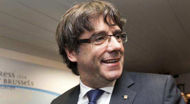 Sacked Catalonian President Carles Puigdemont flew to Brussels (AP Photo/Olivier Matthys)