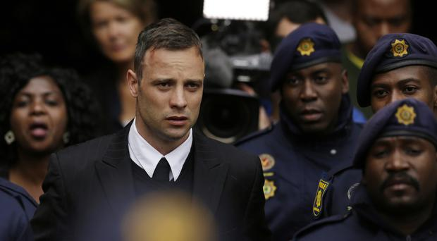 Oscar Pistorius was jailed for six years after he was found guilty of murder for shooting his girlfriend, Reeva Steenkamp (AP Photo/Themba Hadebe, File)