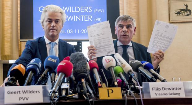 Geert Wilders and Filip Dewinter address the media in Brussels (AP)
