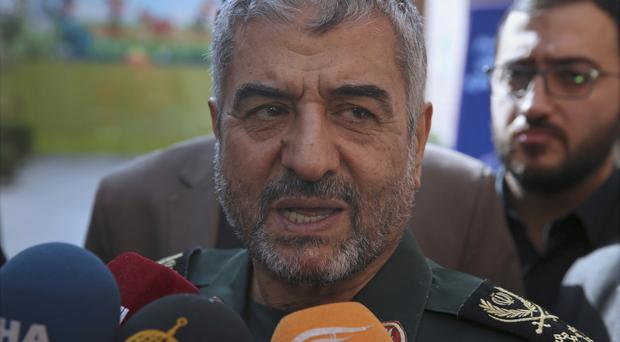 General Mohammad Ali Jafari told a conference called A World Without Terror in Tehran that Iran's supreme leader has limited the range of ballistic missiles it makes to 1,240 miles or 2,000km (AP Photo/Vahid Salemi)