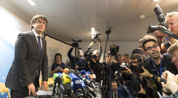 Carles Puigdemont looks on after a press conference in Brussels (AP/Olivier Matthys)