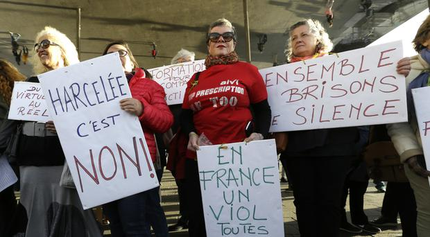 Women hold placards during a demonstration against abuse and harassment in Marseille (AP/Claude Paris)