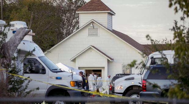 Investigators work at the scene of a mass shooting at the First Baptist Church in Sutherland Springs, Texas (AP)