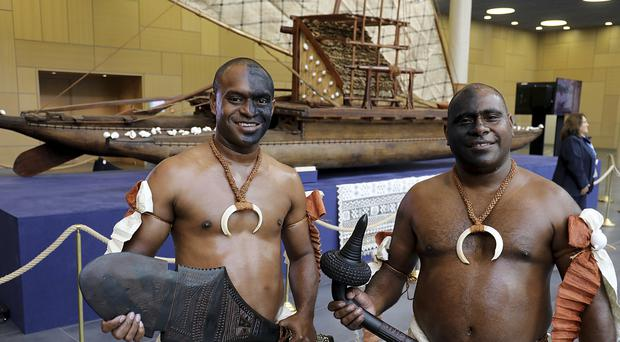 Representatives of the Fiji Islands pose in traditional clothes during the UN World Climate Conference in Bonn, Germany (AP)