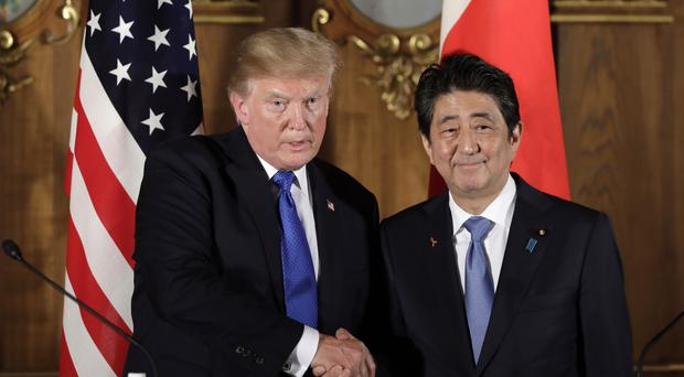 President Donald Trump shakes hands with Japanese Prime Minister Shinzo Abe (AP)
