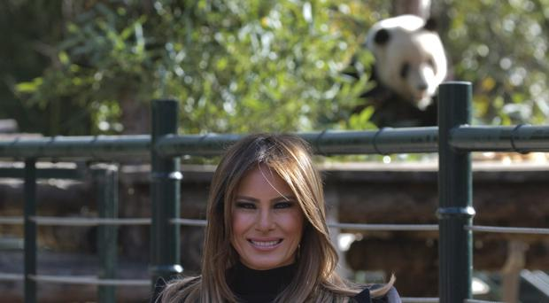 US first lady Melania Trump poses for photos near the panda enclosure at a zoo in Beijing (AP Photo/Ng Han Guan)