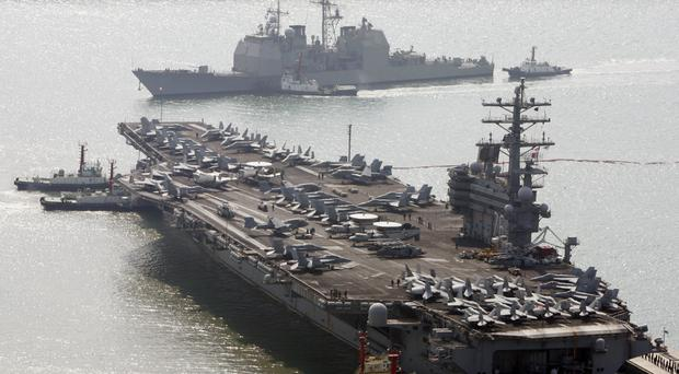 Aircraft carrier USS Ronald Reagan in Busan, South Korea (AP Photo/ Lee Jin-man, File)