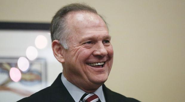 Mr Moore branded the accusations 'fake news' (AP)