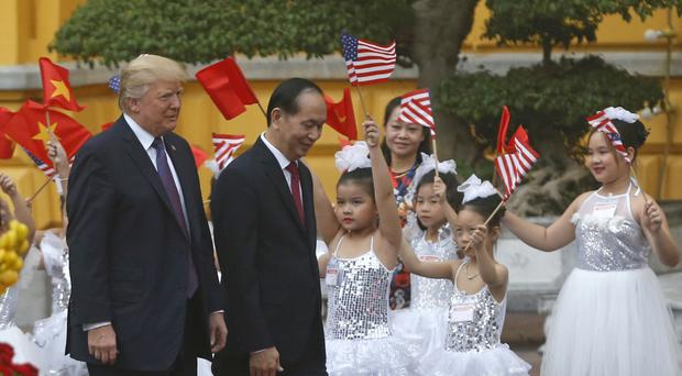 Donald Trump and Vietnam president Tran Dai Quang attend the welcoming ceremony at the Presidential Palace in Hanoi (Kham/Pool Photo via AP)