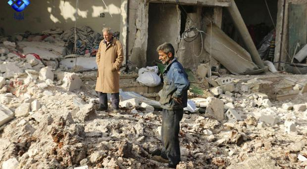 Air raids kill 21 civilians in Syria's Aleppo - monitor