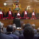 Kenyan Supreme Court judges are hearing petitions challenging President Uhuru Kenyatta's re-election in a repeat presidential poll (Sayyid Abdul Azim/AP/PA)