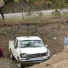 Investigators view a pick-up truck involved in a deadly shooting rampage at the Rancho Tehama Reserve, near Corning, California (AP)
