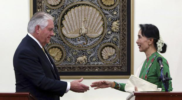 Rex Tillerson and Aung San Suu Kyi shake hands (Aung Shine Oo/AP/PA)