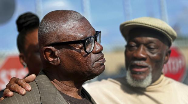 Wilbert Jones talks to the media with his brother Plem Jones, right, after leaving East Baton Rouge Parish Prison (AP)