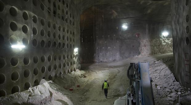 A worker walks at the construction site of a massive underground cemetery in Jerusalem (AP)
