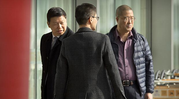 Song Tao, left, arrives at Beijing Capital International Airport for his flight to Pyongyang (AP Photo/Mark Schiefelbein)