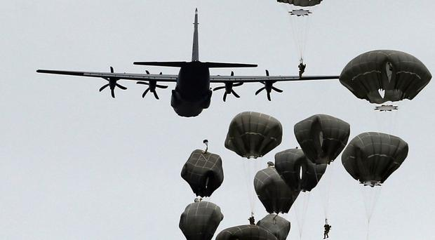 US and Serbian army paratroopers jump from a US Air Force transport aircraft at Lisicji Jarak Airport (AP)