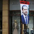 A poster of resigned Lebanese PM Saad Hariri hangs on a street in Beirut (AP)