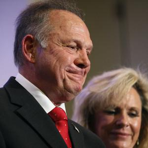 Roy Moore speaks at a news conference in Birmingham, Alabama with his wife Kayla Moore (AP Photo/Brynn Anderson)