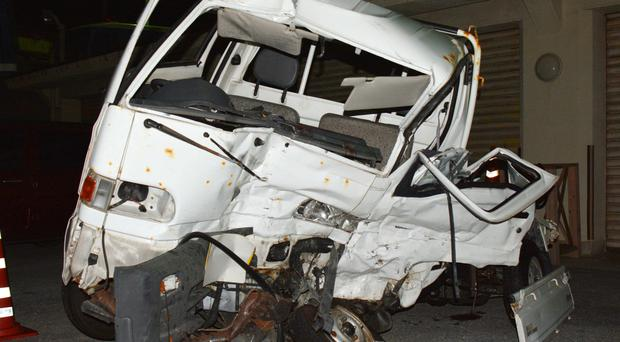 The Japanese driver's damaged vehicle at a police station in Naha, Okinawa (Kazuki Sawada/Kyodo News via AP)